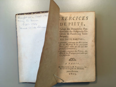 Old book showing inscription inside front cover